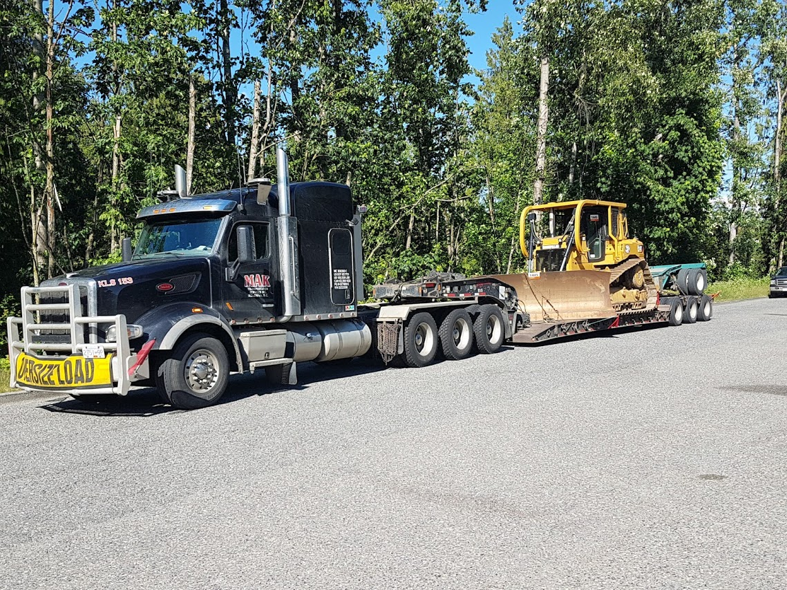 Dozer-on-a-TRI-Drive-Tractor-transport